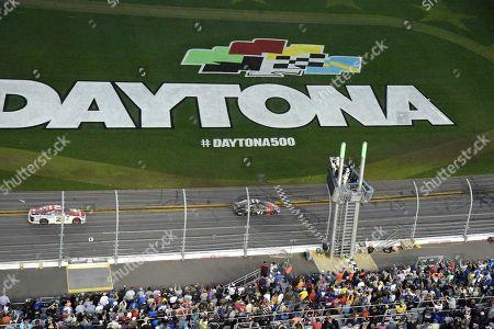 Kurt Busch, Ryan Blaney Kurt Busch (41) crosses the finish line in front of Ryan Blaney (21) to win the NASCAR Daytona 500 auto race at Daytona International Speedway, in Daytona Beach, Fla