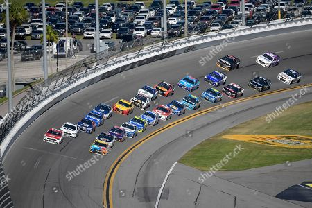 Ryan Blaney, Kyle Busch Ryan Blaney (21), front left, and Kyle Busch (18) lead a pack of drivers through Turn 4 during the NASCAR Daytona 500 auto race at Daytona International Speedway, in Daytona Beach, Fla