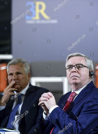 Stock Photo of Former Polish President Aleksander Kwasniewski (L) and former President of the European Parliament Pat Cox (R) during the international symposium 'Three Revolutions - Portraits of Ukraine' in Warsaw, Poland, 28 February 2017. The goal of the research project is a multi-dimensional analysis of the three major protests that took place in Ukraine from 1990: A revolution on granite (1990), the Orange Revolution (2004-2005) and Euromaidan (2013-2014), as well as encouraging further scientific debate.