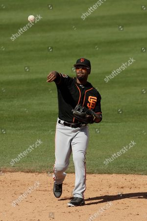 San Francisco Giants shortstop Jimmy Rollins throws during the third inning of a spring training baseball game against the San Diego Padres, in Peoria, Ariz