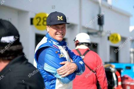 Driver Michael Waltrip stands outside his garage stall during a practice session for Sunday's Daytona 500 at Daytona International Speedway, in Daytona Beach, Fla