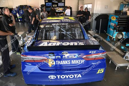 Michael Waltrip (15)'s car sits in his garage stall during a practice session for Sunday's Daytona 500 at Daytona International Speedway, in Daytona Beach, Fla