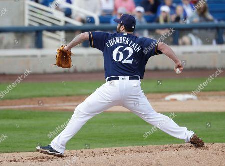 Stock Image of Milwaukee Brewers' Joba Chamberlain throws during a spring training baseball game, in Phoenix