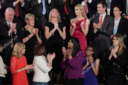 """Carryn Owens, widow of widow of Chief Special Warfare Operator William """"Ryan"""" Owens, is applauded on Capitol Hill in Washington, as she was acknowledged by President Donald Trump during his address to a joint session of Congress"""