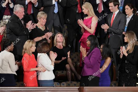 """Carryn Owens, widow of widow of Chief Special Warfare Operator William """"Ryan"""" Owens, looks upward on Capitol Hill in Washington, as she was acknowledged by President Donald Trump during his address to a joint session of Congress"""
