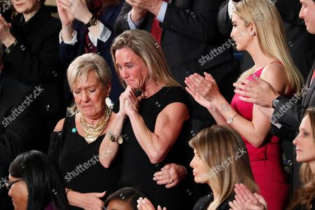 """An emotional Carryn Owens, widow of widow of Chief Special Warfare Operator William """"Ryan"""" Owens, on Capitol Hill in Washington, as she was acknowledged by President Donald Trump during his address to a joint session of Congress"""