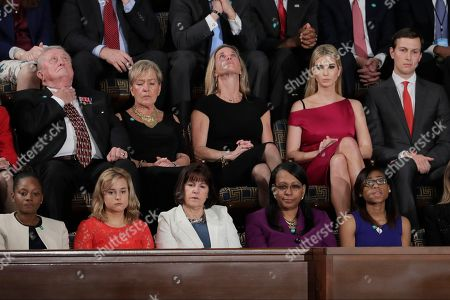 """Carryn Owens, widow of widow of Chief Special Warfare Operator William """"Ryan"""" Owens, looks upward on Capitol Hill in Washington, during President Donald Trump's address to a joint session of Congress"""