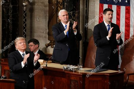 """President Donald Trump, Vice President Mike Pence and House Speaker Paul Ryan of Wis. applaud Carryn Owens, widow of widow of Chief Special Warfare Operator William """"Ryan"""" Owens, on Capitol Hill in Washington, during the president's address to a joint session of Congress"""