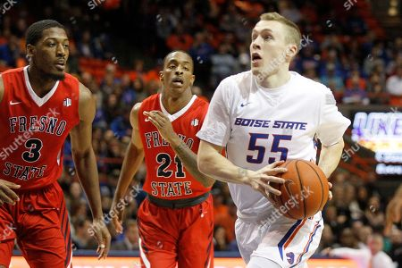 James Reid, Paul Watson Boise State's James Reid (55) looks to the basket past Fresno State's Paul Watson (3) during the first half of an NCAA college basketball game in Boise, Idaho