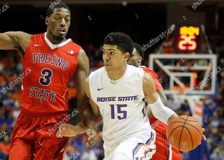 Chandler Hutchison, Paul Watson Boise State's Chandler Hutchison (15) moves the ball past Fresno State's Paul Watson (3) during the first half of an NCAA college basketball game in Boise, Idaho