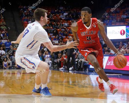 Paul Watson, Nick Duncan Fresno State's Paul Watson (3) moves the ball around Boise State's Nick Duncan during the first half of an NCAA college basketball game in Boise, Idaho