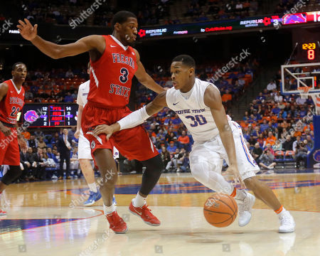 Paris Austin, Paul Watson Boise State's Paris Austin (30) moves the ball around Fresno State's Paul Watson (3) during the first half of an NCAA college basketball game in Boise, Idaho, . Fresno State won 74-67