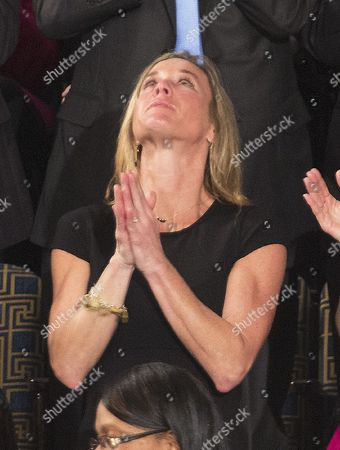 Carryn Owens (black dress), the widow of William Ryan ' Owens, a Navy Seal killed in the Trump administration's first counterterrorism operation in Yemen looks skyward