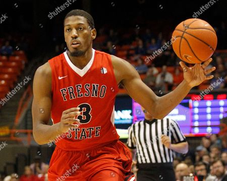 Fresno State's Paul Watson (3) moves the ball during the first half of an NCAA college basketball game against Boise State in Boise, Idaho, . Fresno State won 74-67