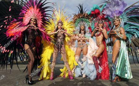Performers from the band Ultra Violet Jungle by Luis Hart participate in the last day of carnival celebrations at the Queen's Park Savannah in Port of Spain, Trinidad and Tobago, 28 February 2017.