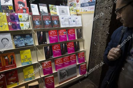 A Man Looks at Books by Italian Novelist Umberto Eco Titled 'Pape Satan Aleppe Chronicles of a Liquid Society' Displayed in a Book Store in Siena Italy 26 March 2016 Umberto Eco Died at the Age of 84 on 19 February 2016 Italy Siena