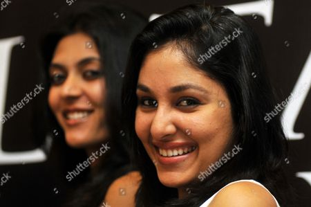 Winners of the Femina Miss India 2009 Contest Miss Earth Shriya Kishore (l) with Miss World Pooja Chopra (r) Pose For the Photographs During a Promotional Event in Southern Indian City of Bangalore on 17 June 2009 India Bangalore