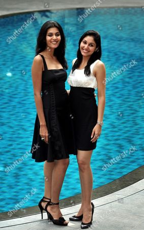Stock Image of Winners of the Femina Miss India 2009 Contest Miss Earth Shriya Kishore (l) with Miss World Pooja Chopra (r) Pose For the Photographs During a Promotional Event in Southern Indian City of Bangalore on 17 June 2009 India Bangalore