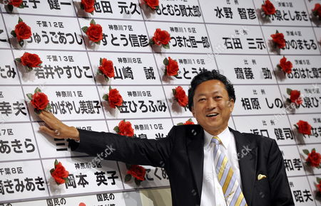 Democratic Party of Japan (dpj) President Yukio Hatoyama Smiles As He Puts a Rosette on the Name of an Elected Candidate at the Dpj's Elections Headquarters in Tokyo Japan 30 August 2009 According to Local Media the Main Opposition Democratic Party of Japan Appears Certain to Achieve a Landslide Victory Over the Liberal Democratic Party (ldp) in the General Election by Winning More Than 300 of the 480 Seats in the Powerful House of Representatives Hatoyama is Set to Become the New Prime Minister to Replace the Ldp's Taro Aso Japan Tokyo