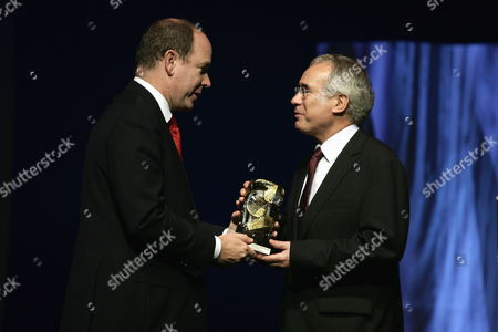Prince Albert Ii of Monaco (l) Hands Over a Special Award to Lord Nicholas Stern Chair of the Grantham Research Institute on Climate Change at the London School of Economics During the Second Edition of the Prince Albert Ii of Monaco Foundation's Award Ceremony and the World Premiere of the Film Oceans by French Directors Jacques Perrin and Jacques Cluzaud at Grimaldi Forum in Monaco 10 October 2009 Monaco Monaco