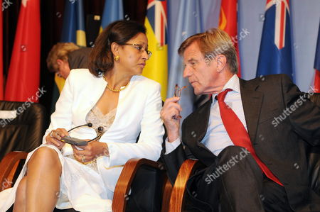 French Secretary of State For Overseas Territories Marie-luce Penchard (l) Chats with French Foreign Minister Bernard Kouchner (r) Before the Start of the Press Conference at the End of the 3rd France-oceania Summit in Noumea New Caledonia 31 July 2009 the One-day Meeting Hosted by French Foreign Minister Bernard Kouchner Ended Amid Expressions of Shared Concern Over the Effects of Climate Change the Summit Also Focused on Regional Security Development and Environment Issues New Caledonia Noumea