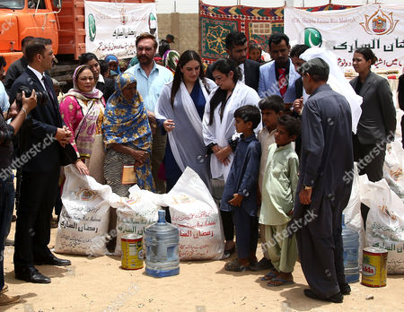 Bakhtawar Bhutto Zardari (c) and Asifa Bhutto Zardari (4-r) Leaders of Opposition Party Pakistan People Party (ppp) and Daughter of Slain Former Prime Minister Benazir Bhutto Distribute Ration Food Ahead of Ramadan in Sufian Village Jokhio Bedaub Sindh Province Pakistan 31 May 2016 Pakistan Jokhio