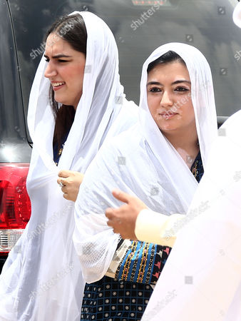 Bakhtawar Bhutto Zardari (l) Asifa Bhutto Zardari (r) Leaders of Opposition Party Pakistan People Party (ppp) and Daughter of Slain Former Prime Minister Benazir Bhutto Distribute Ration Food Ahead of Ramadan in Sufian Village Jokhio Bedaub Sindh Province Pakistan 31 May 2016 Pakistan Jokhio
