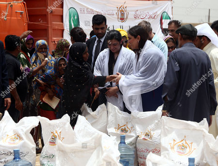 Bakhtawar Bhutto Zardari (2-r) and Asifa Bhutto Zardari (3-r) Leaders of Opposition Party Pakistan People Party (ppp) and Daughter of Slain Former Prime Minister Benazir Bhutto Distribute Ration Food Ahead of Ramadan in Sufian Village Jokhio Bedaub Sindh Province Pakistan 31 May 2016 Pakistan Jokhio