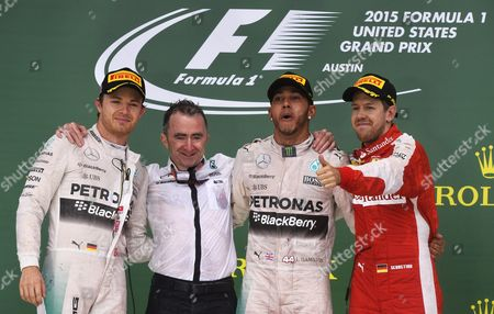 German Formula One Driver Nico Rosberg of Mercedes Amg Gp (l-r) Technical Executive Director of Mercedes Amg Paddy Lowe British Formula One Driver Lewis Hamilton of Mercedes Amg Gp and German Formula One Driver Sebastian Vettel of Scuderia Ferrari Celebrate on the Podium After the Race at the Circuit of the Americas in Austin Texas Usa 25 October 2015 Lewis Hamilton Retained His Formula One World Title by Winning the United States Grand Prix Securing an Unassailable Lead As Team-mate Nico Rosberg was Second and Ferrari's Sebatian Vettel Third Epa/larry W Smith United States Austin