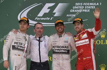 British Formula One Driver Lewis Hamilton (2-r) of Mercedes Amg Gp Poses with Paddy Lowe (2-l) British Motor Racing Engineer and Executive Director of Mercedes Formula One German Formula One Driver Nico Rosberg of Mercedes Amg Gp (l) and German Formula One Driver Sebastian Vettel of Scuderia Ferrari (r) After Winning the United States Grand Prix at the Circuit of the Americas in Austin Texas Usa 25 October 2015 Lewis Hamilton Retained His Formula One World Title by Winning the United States Grand Prix Securing an Unassailable Lead As Team-mate Nico Rosberg was Second and Ferrari's Sebatian Vettel Third United States Austin