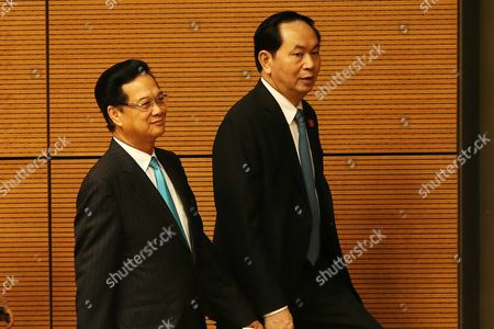 Vietnam's President Tran Dai Quang (r) and Former Prime Minister Nguyen Tan Dung (l) Leave the Hall After the Closing of the First Session of the 14th National Assembly in Hanoi Vietnam 29 July 2016 the Assembly Runs From 20 to 29 July Viet Nam Hanoi
