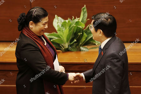 Deputy Chairwoman of the National Assembly of Vietnam Tong Thi Phong (l) Shakes Hands with Vietnam's President Truong Tan Sang (r) at the Opening Session of the Eleventh Session of the National Assembly's 13th Tenure at the National Assembly Office in Hanoi Vietnam 21 March 2016 Viet Nam Hanoi