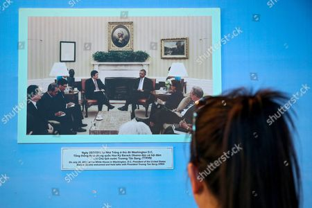 Stock Picture of A Woman Looks at a Picture of Us President Barack Obama (c-r) Meeting His Vietnamese Counterpart Truong Tan Sang (c-l) at the White House on 25 July 2013 Displayed at the Vietnam War Remnants Museum in Ho Chi Minh City Vietnam 23 May 2016 Us President Obama is in Vietnam For the First Time From 23 to 25 May 2016 Making It the Third Us President to Visit the South East Asian Country Since the End of the Vietnam War in 1975 During the First Day of His Visit Obama Announced That the Us Will Lift Its Arms Embargo on Weapon Sales to Vietnam Viet Nam Ho Chi Minh City