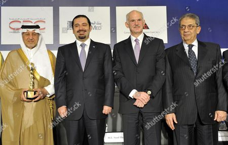 Saudi Prince Khaled Al-faisal Bin Abdul Aziz Al-saud Governor of Mecca (l) Lebanese Prime Minister Saad Hariri (2l) with His Greek Counterpart George Papandreou (2r) and Arab League Secretary General Amr Mussa (r) Pose For a Group Picture During the Opening Session of the 18th Arab Economic Forum in Beirut Lebanon 20 May 2010 Lebanon Beirut