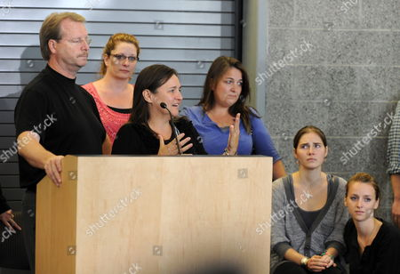 Us Student Amanda Knox (2-r) Listens As Her Mother Edda Mellas (at Podium) and Her Father (l) Address the Media at the Sea-tac Airport in Seattle Washington Usa a Day After Her Release From Prison in Italy 04 October 2011 Amanda Knox was Acquitted of Murder and Sexual Assault by an Italian Appeals Court After Spending Four Years in Custody Over the Killing of Her British Housemate Meredith Kercher United States Seattle