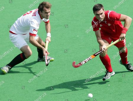 Stock Picture of Poland's Michal Raciniewski (r) in Action Against Canada's Philip Wright (l) During the Men's Field Hockey Olympic Qualification Match Between Canada Vs Poland Held in New Delhi India on 19 February 2012 India New Delhi