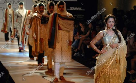 Stock Image of Bollywood Actress Amrita Arora Khan (r) Presents a Creation by Indian Designer Vikram Phadnis with Models at the Lakme Fashion Week (lfw) in Mumbai India 02 March 2012 Some 83 Designers Are Showcasing Their Collections at the Lfw Summer/resort 2012 Until 06 March India Mumbai