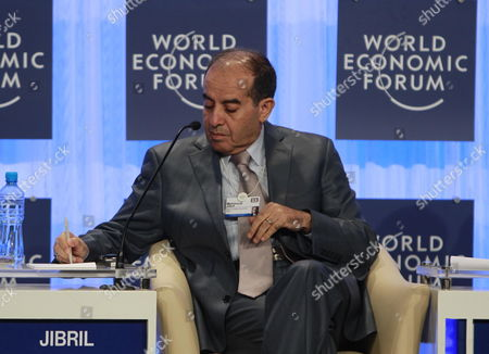 Libyan Head of Executive Board of Libya's Ruling National Transitional Council (tnc) Mahmoud Jibril Writes Notes During the Opening Ceremony of World Economic Forum Dead Sea West of Amman Jordan 22 October 2011 the World Economic Forum is Having a Special Meeting on Economic Growth and Job Creation in the Arab World Between 21 and 23 October the Meeting Will Bring Participants From Over the World For Discussions on Best Practices in Economic Policy and Reform and Elaborate Concrete Ways in Which All Stakeholders Can Drive Positive Outcomes Across the Region Jordan Dead Sea