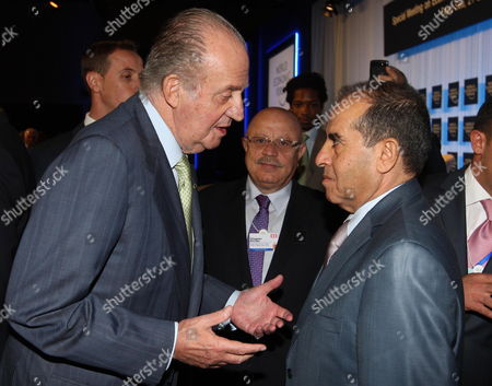 Spanish King Juan Carlos (l) Greets Libyan Head of Executive Board of Libya's Ruling National Transitional Council (tnc) Mahmoud Jibril (r) at World Economic Forum Dead Sea West of Amman Jordan on 22 October 2011 the World Economic Forum is Having a Special Meeting on Economic Growth and Job Creation in the Arab World Between 21 and 23 October the Meeting Will Bring Participants From Over the World For Discussions on Best Practices in Economic Policy and Reform and Elaborate Concrete Ways in Which All Stakeholders Can Drive Positive Outcomes Across the Region Jordan Dead Sea