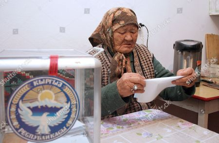 An Kyrgyz Elderly Woman Prepares to Cast Her Ballot Into a Portable Ballot Box During Early Kyrgyzstan Presidential Voting at Her House in the Village of Strelnikovo Some 25 Km From Bishkek Kyrgyzstan 29 October 2011 Kyrgyzstan Will Elect a New President on 30 October in a Vote That Will Also Determine Whether Central Asia's Only Democratic State Can Remain Free of Dictators Around 20 Candidates Are Vying to Take Over From Incumbent President Roza Otunbayeva an Interim Leader Appointed to the Job After the Ouster of President Kurmanbek Bakiyev who was Toppled by Bloody Protests in April 2010 Kyrgyzstan Strelnikovo