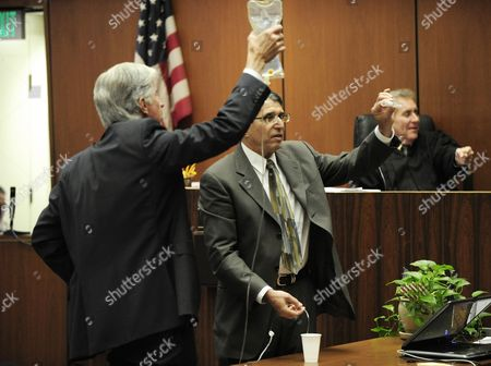 Dr Paul White (r) an Anesthesiologist and Propofol Expert Demonstrates with an Iv Drip with the Assistance of Defense Attorney J Michael Flanagan (l) During the Final Stage of Dr Conrad Murray's Defense Case in the Involuntary Manslaughter Trial in the Death of Singer Michael Jackson at the Los Angeles Superior Court in Los Angeles California Usa 28 October 2011 the Harlem Globetrotters the Popular Exhibition Basketball Team That Combines Athletics and Comedy is in Lebanon to Entertain Fans Lebanon Beirut