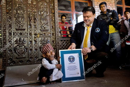 Craig Glenday (r) Chief Editor of the Guinness Book of Records Hands Over a Certificate to Nepalese Chandra Bahadur Dangi (l) After He was Officially Recognized and Certified the 'Shortest Man Ever' and 'Shortest Man Living' by Guinness World Records During a Ceremony in Kathmandu Nepal 26 February 2012 the Guinness Team Led by Craig Glenday Handed Over the Certificates For the Shortest Man Living who is Measuring 54 6 Centimeters (21 5 Inches) Nepal Kathmandu