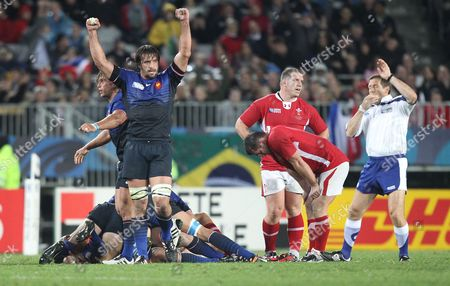 Wales's Players Look Dejected As France's Lionel Nallet (l) and Team Mates Celebrate After Referee Alain Rolland (r) Blows the End of the Semi Final 1 Match in the Rugby World Cup 2011 Played at Eden Park Auckland New Zealand 15 September 2011 New Zealand Auckland