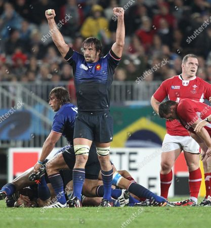 Wales's Players Look Dejected As France's Lionel Nallet (l) and Team Mates Celebrate After Referee Alain Rolland (unsighted) Blows the End of the Semi Final 1 Match in the Rugby World Cup 2011 Played at Eden Park Auckland New Zealand 15 September 2011 New Zealand Auckland