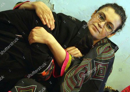 Ghanwa Bhutto (r) Leader of the Political Party Pakistan People Party (shaheed Bhutto Group) and Daughter-in-law of Begum Nusrat Bhutto the Mother of Slain Former Prime Minister Benazir Bhutto Comforts Her Daughter Fatima Bhutto Following the Death of Nusrat Bhutto in Larkana Pakistan 24 October 2011 Reports State That Nusrat Bhutto the Mother of Slain Former Prime Minister Benazir Bhutto Widow of Former Prime Minister Zulfiqar Ali Bhutto and Mother-in-law of Current Pakistani President Asif Zardari Died in Dubai on 23 October After a Long Illness Nusrat Bhutto Has Been in Failing Health Following a Stroke and the Onset of Alzheimers Disease Pakistan Larkana