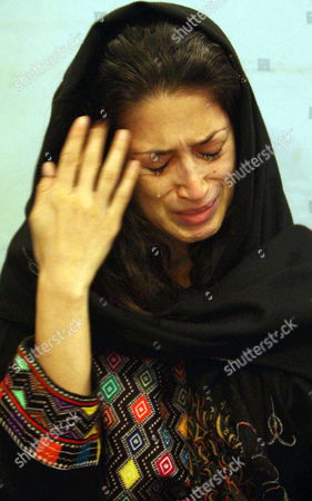 Fatima Bhutto Grand-daughter of Begum Nusrat Bhutto the Mother of Slain Former Prime Minister Benazir Bhutto Cries Following the Death of Nusrat Bhutto in Larkana Pakistan 24 October 2011 Reports State That Nusrat Bhutto the Mother of Slain Former Prime Minister Benazir Bhutto Widow of Former Prime Minister Zulfiqar Ali Bhutto and Mother-in-law of Current Pakistani President Asif Zardari Died in Dubai on 23 October After a Long Illness Nusrat Bhutto Has Been in Failing Health Following a Stroke and the Onset of Alzheimers Disease Pakistan Larkana