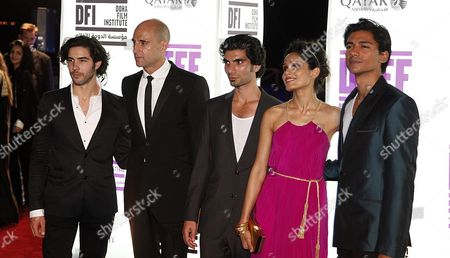Cast Members of 'Black Gold' (l-r) Tahar Rahim Mark Strong Akin Gazi Freida Pinto and Jan Uddin Arrive at the 'Black Gold' World Premiere During Doha Tribeca Film Festival Opening Night at Katara Open Air Theatre During the Doha Tribeca Film Festival in Doha Qatar on 25 October 2011 Qatar Doha