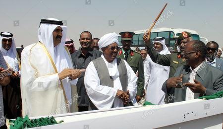 Crown Prince of Qatar Sheikh Hamad Bin Jassim Bin Jaber Bin Muhammad Al Thani (l) and Sudanese President Omar Hassan Al-bashir (c) Inaugurating a Road to Neighboring Ethiopia in Kassala Sudan 26 October 2011 Sudan Kassala