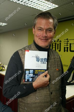 Belgian Economist and Founder of the Zero Emissions Research & Initiatives Network Gunter Pauli Displays the Chinese Edition of His Book the Blue Economy at a News Conference in Taipei Taiwan 31 January 2012 Pauli is Invited to Attend the 2012 Taipei International Book Exhibition Which Opens Wednesday with the Focus on Green Reading Taiwan Taipei