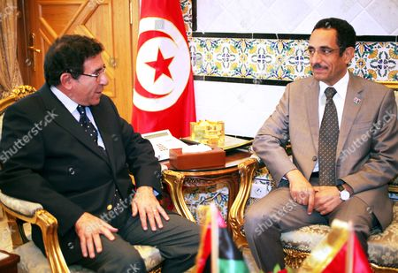 Tunisian Secretary of State For Foreign Affairs Radhouan Nouisser (l) Meets with Libya's National Transition Council (ntc) Vice Chairman and Spokesman Abdul Hafiz Ghoga (r) in Tunis Tunisia on 07 October 2011 Ghoga Arrived in Tunisia on 06 October with a Group of Injured Rebels For Medical Treatment in Tunisia Tunisia Tunis